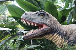 Angry dinosaur in botanicl garden
