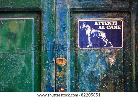 Angry dog sign on a door, Italy