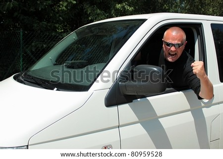 angry driver cursing, aggressive driver of the big white car, black shirt
