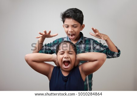Angry elder brother attcks his sister #1010284864