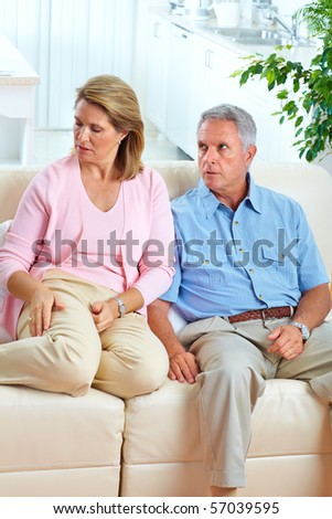 Angry elderly couple at home. Divorce