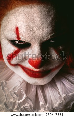 angry evil clown face looking at camera close up