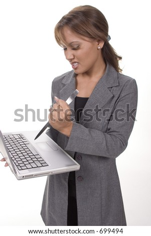 Angry executive woman attacking her laptop