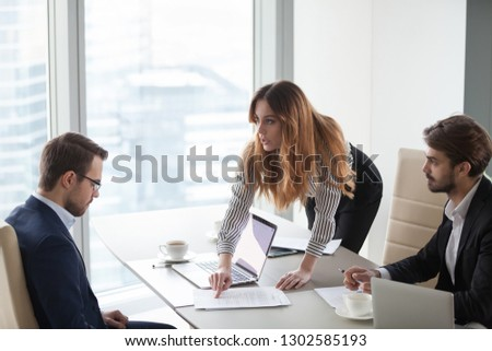 Angry female client customer worker pointing at mistake in business document having complaint demanding change in terms or money compensation detect fraud, business partners contract breach concept