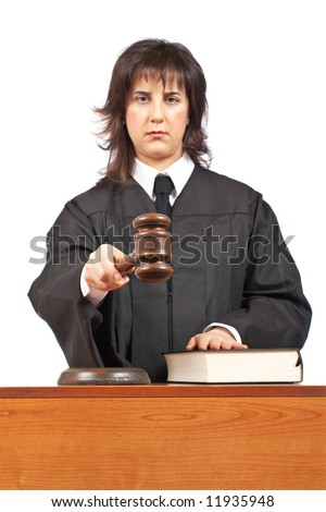 Angry female judge pointing at you in a courtroom. Focus on gavel and shallow depth of field