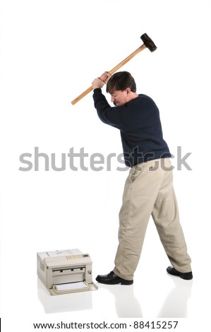Angry, frustrated man swings sledge-hammer into printer isolated on white