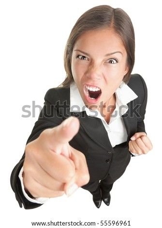 Angry funny businesswoman isolated on white background looking and pointing upset at camera. Full body in high and wide angle view.