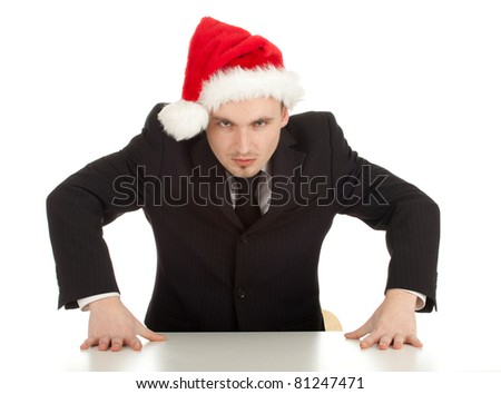 angry, furious  businessman in black suit and red Christmas hat