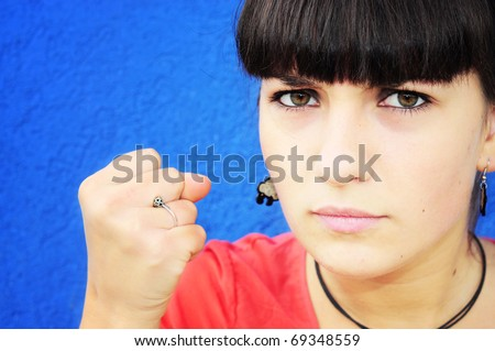 Angry girl showing fist