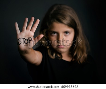 Angry girl showing hand signaling to stop   #659933692