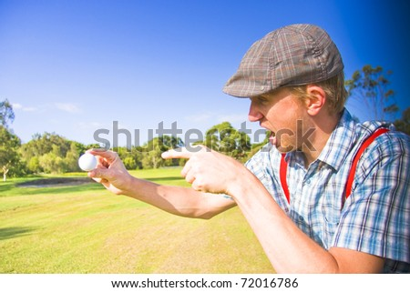 Angry Golf Sees A Sports Man Screaming Out In A Fit Of Rage On A Golf Course While Pointing At His Golf Ball After A Unsuccessful Golfing Game