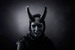 Angry horned demon in the dark