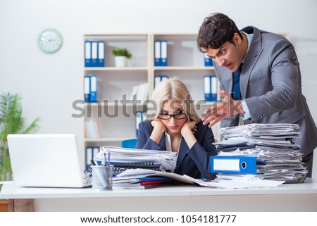 Angry irate boss yelling and shouting at his secretary employee #1054181777