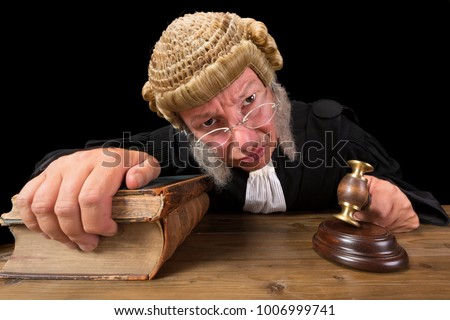 Angry judge in extreme wide angle closeup with hammer and wig ストックフォト ©
