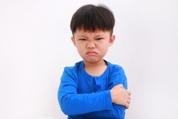 Angry little asian boy showing frustration and disagreement, isolated on white background