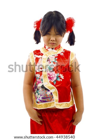 Angry little asian girl staring someone or something, isolated over white. - stock photo