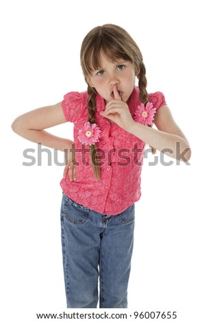 Angry little girl with finger on lips, on white background.