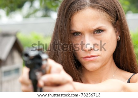 Angry Looking Woman Points 38 Special Snub-nose Revolver Gun