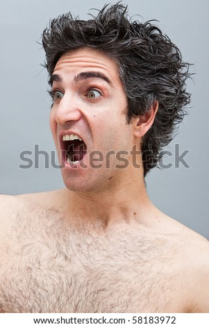 Angry looking young man screaming