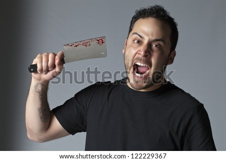 Angry man about to kill using butcher knife with blood