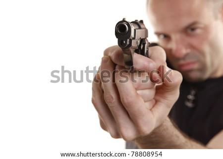 Angry man aims with handgun