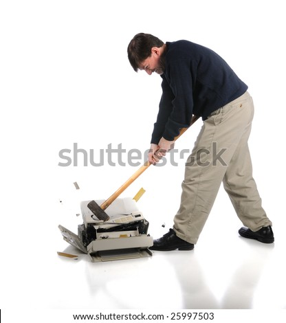 Angry man breaks printer into pieces with a sledgehammer