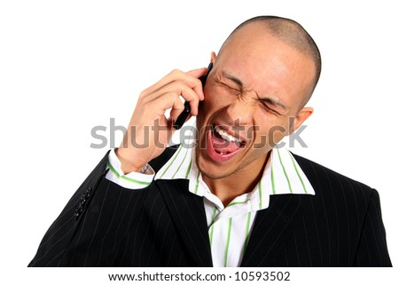 Angry Man On Phone Stylish young man in suit screaming into his cell phone. Isolated over white.