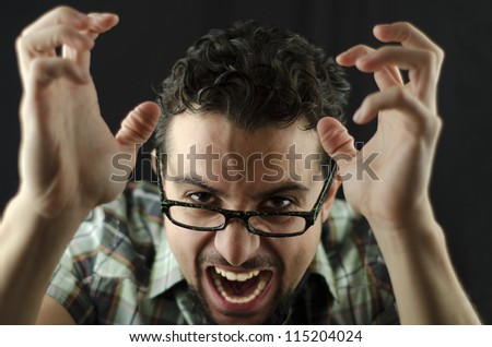 Angry man over dark background