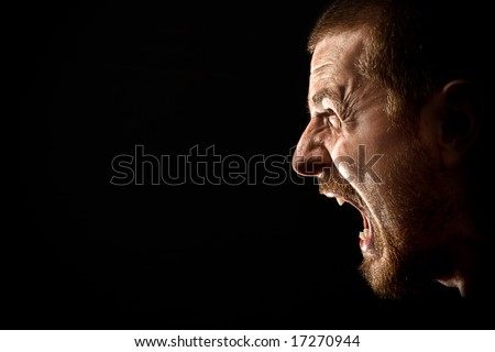 Angry man screaming in extreme rage