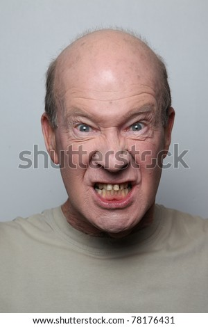 Angry man showing his teeth