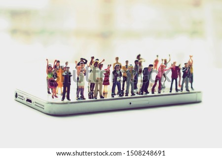 Angry mob of various, diverse people on a phone. Social media addiction concept or people mistreating one another online. Group mentality or cancelled culture. Men and women arguing over politics. Stockfoto ©