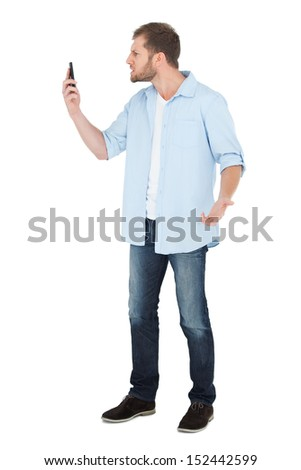 Angry model on the phone on white background