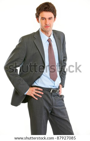 Angry modern businessman with hand on hips  isolated on white