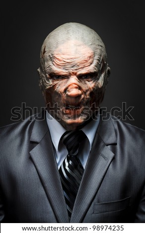 Angry monster in business suit