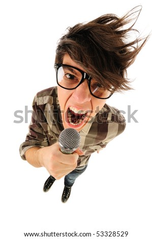 Angry nerdy guy with thick glasses shouting in the microphone, humor style, from above, isolated on white