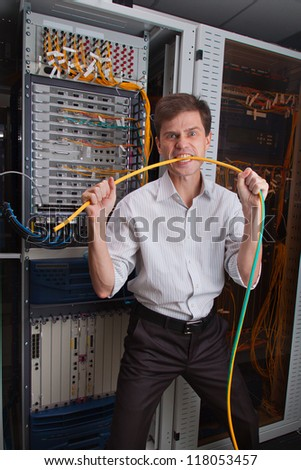 Angry Network engineer in server room bites cable