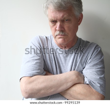 angry older man with his arms crossed