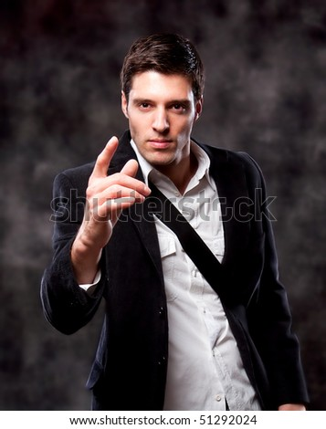 Angry Pointing Businessman isolated on dark background