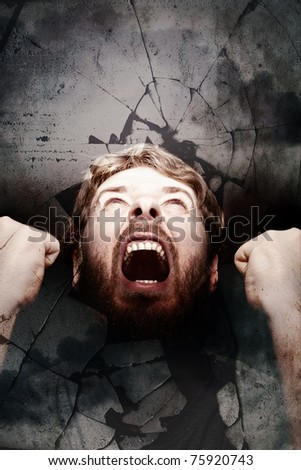 Angry scream of revolution and shattered glass - stock photo