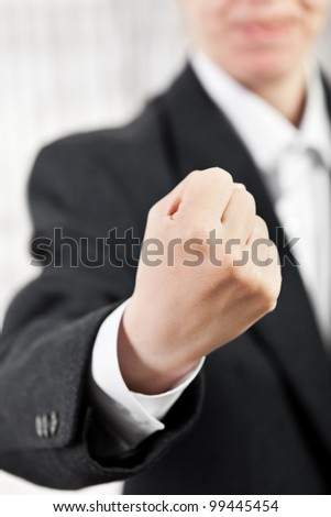 Angry screaming business man hand gesturing fist