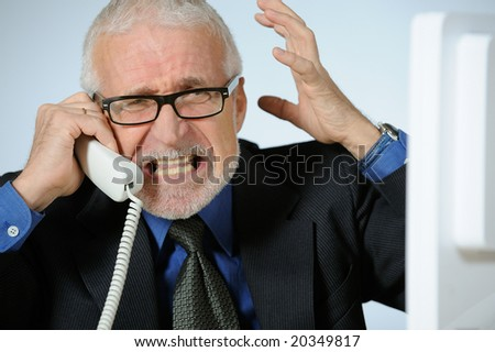 Angry senior businessman