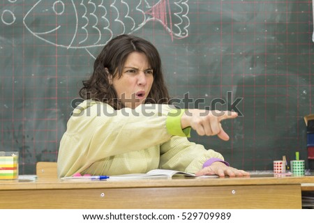 Angry  teacher pointing out on backboard background