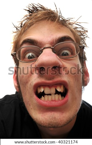 stock photo : Angry ugly man with crooked teeth and glasses isolated on