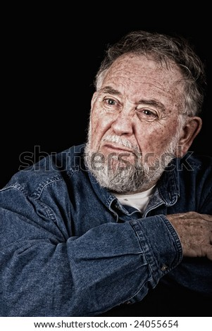 angry very old man over black background, wrinkles burned in - stock photo
