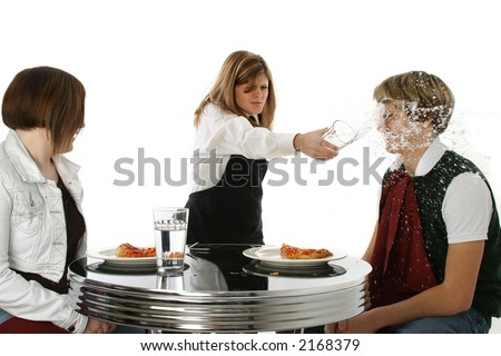 Angry waitress throwing drink in customer's face.