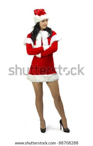 Angry woman dressed in Santa Claus costume with arms crossed