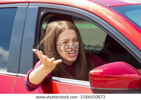 Angry woman driver screaming in the car. The quarrel and dissatisfaction on the way. Сток-фото ©
