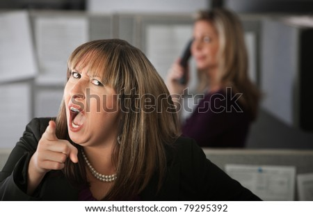 Angry woman employee pointing index finger
