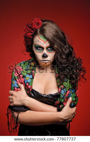 Angry Woman in makeup for Dia De Los Muertos with roses in her hair - stock photo
