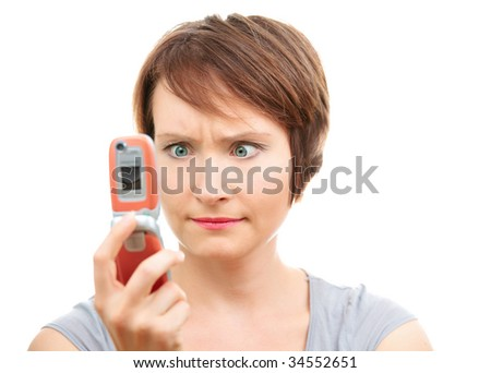 Angry woman reading message on her cell-phone isolated on white